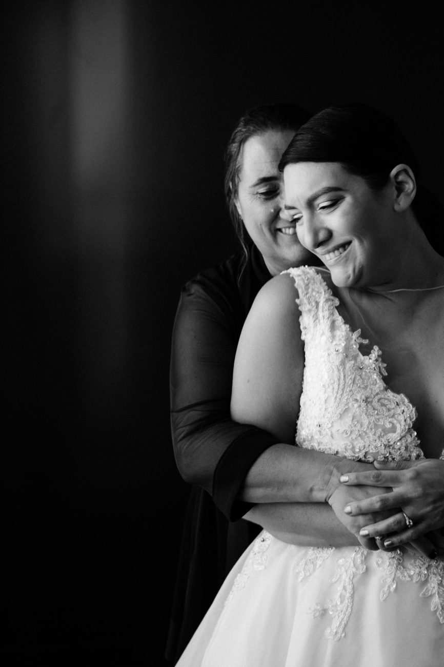 mother of the bride hug on wedding day