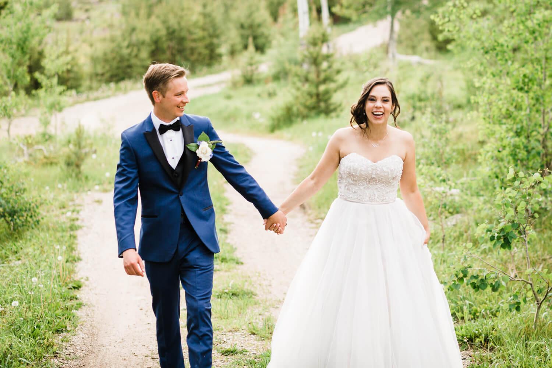 man looking at bride as she looks at the camera