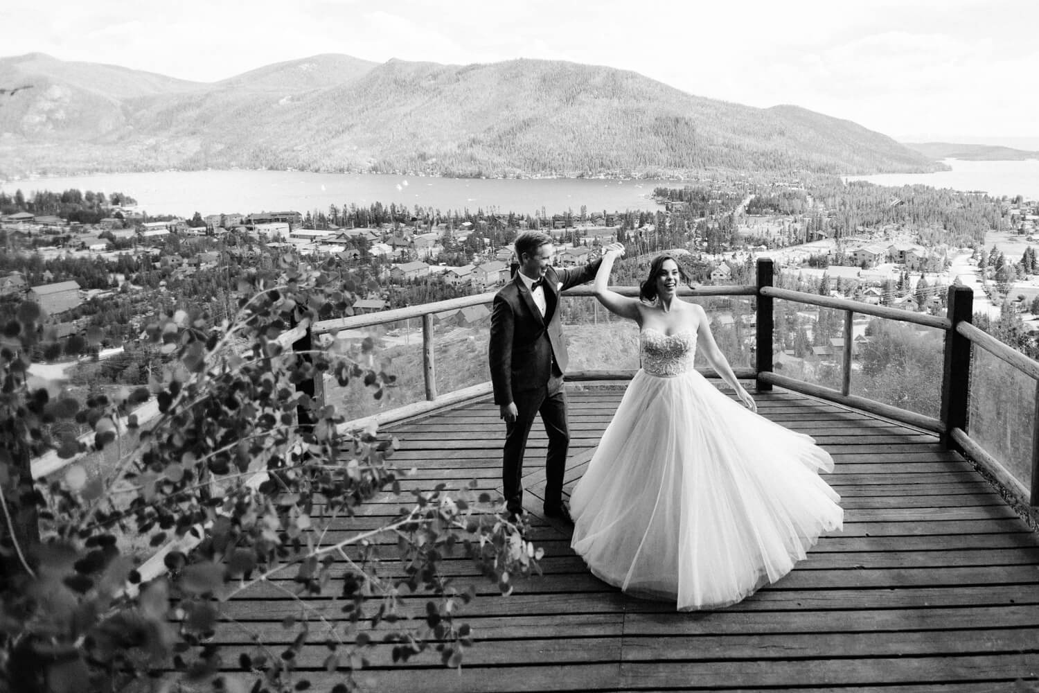 bride and groom dancing in front of beautiful scenery