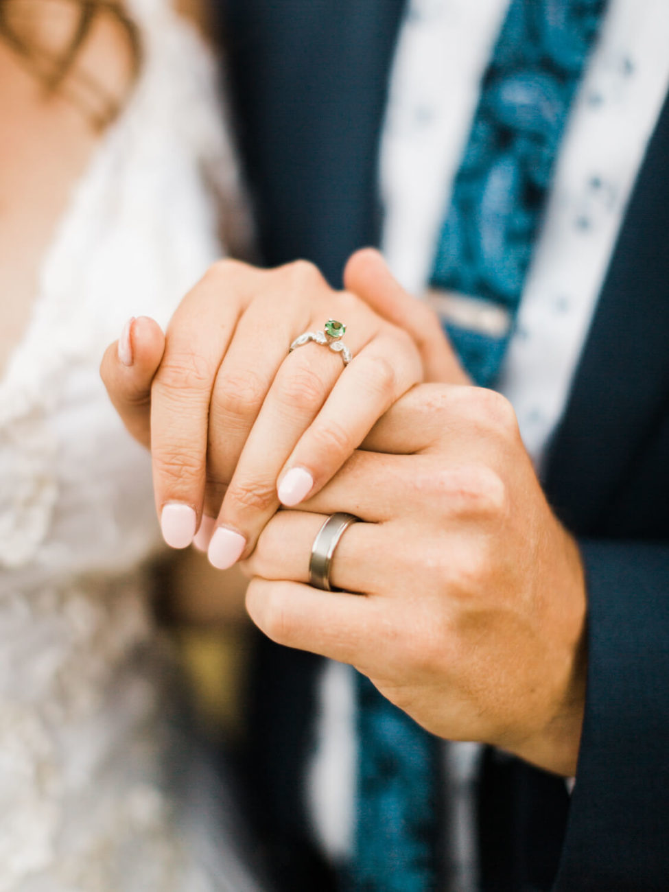 bride and groom hands showing wedding rings