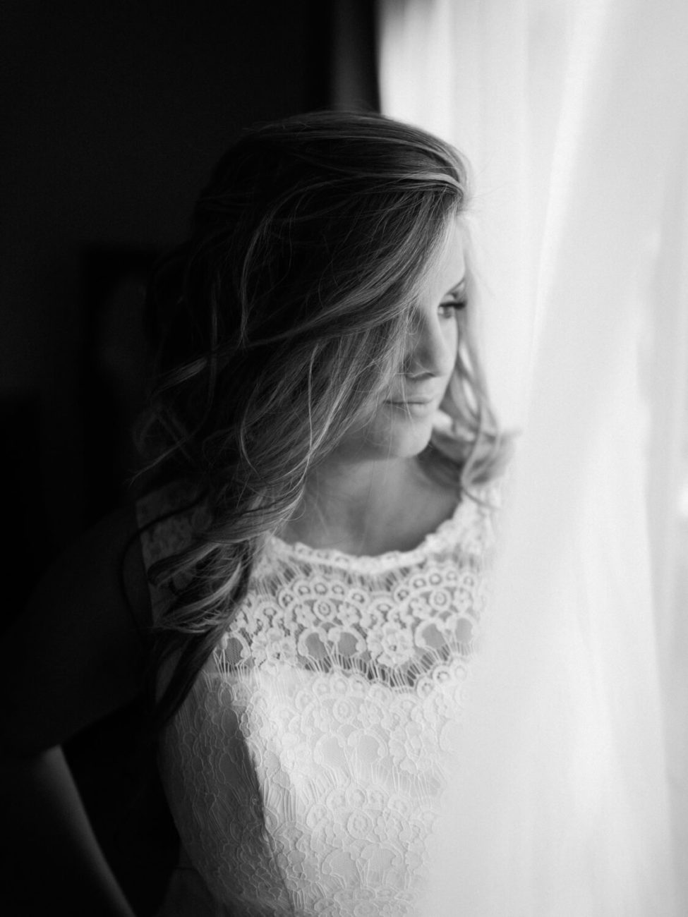 black and white photo of bride on wedding day