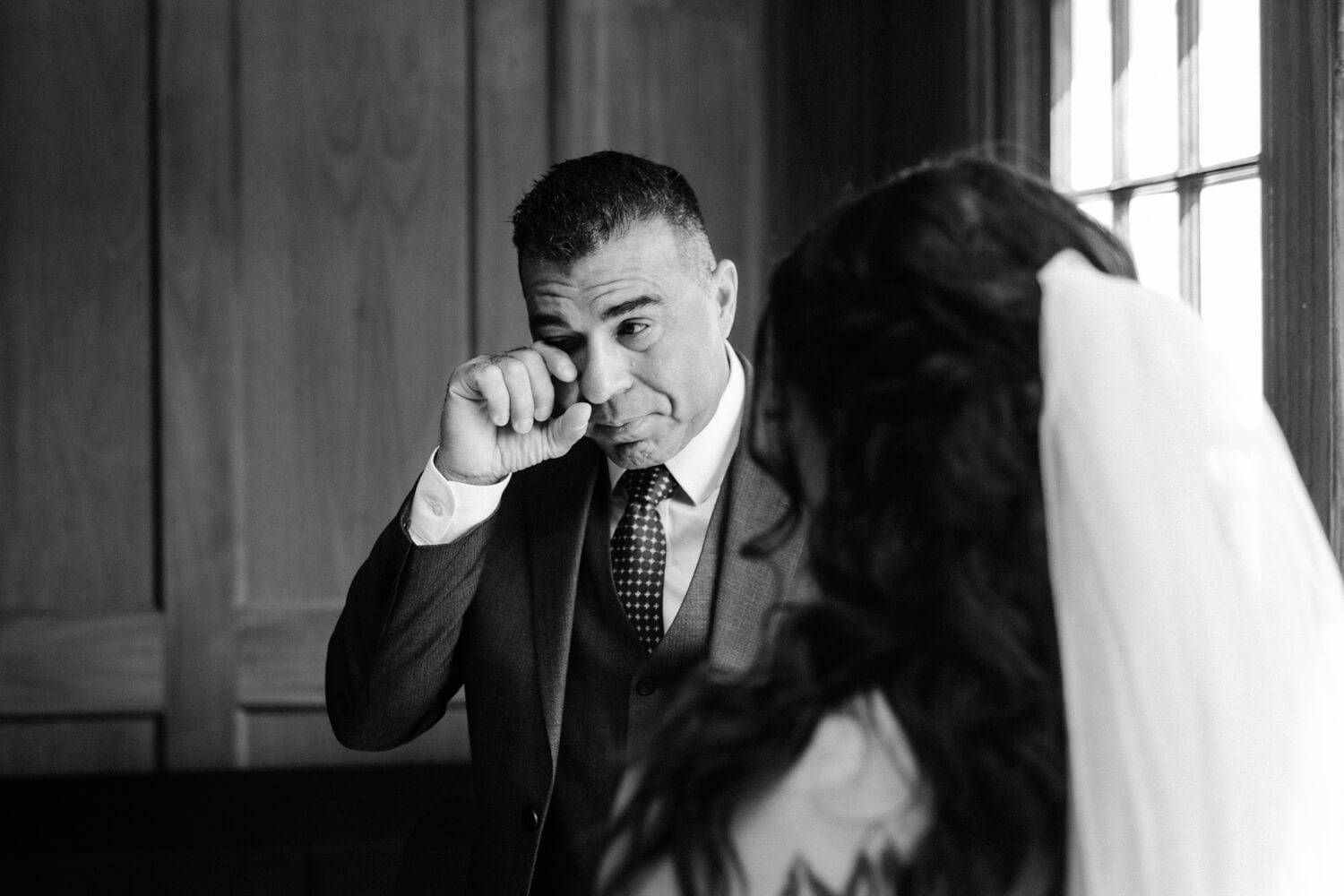father of the bride crying for a wedding photographer in denver