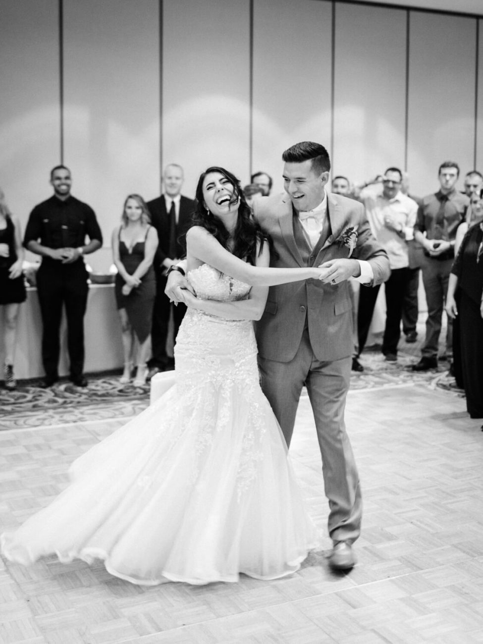 bride and groom dancing and laughing