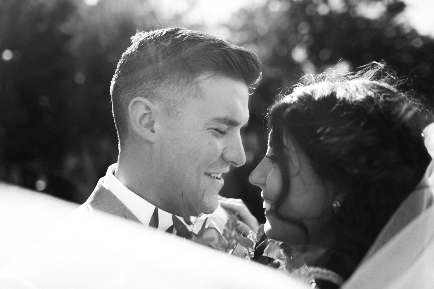 bride and groom black and white laughing