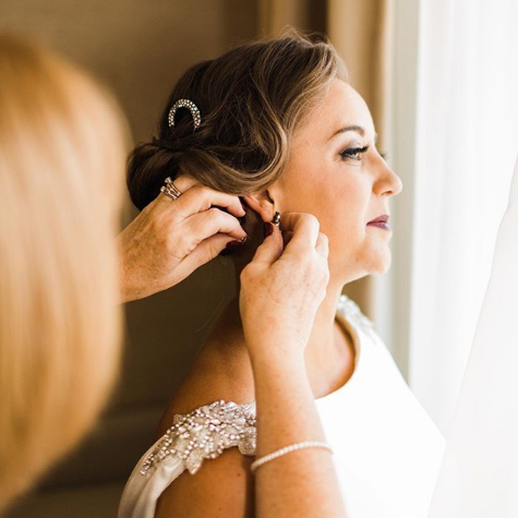 bride getting ready on wedding day photography