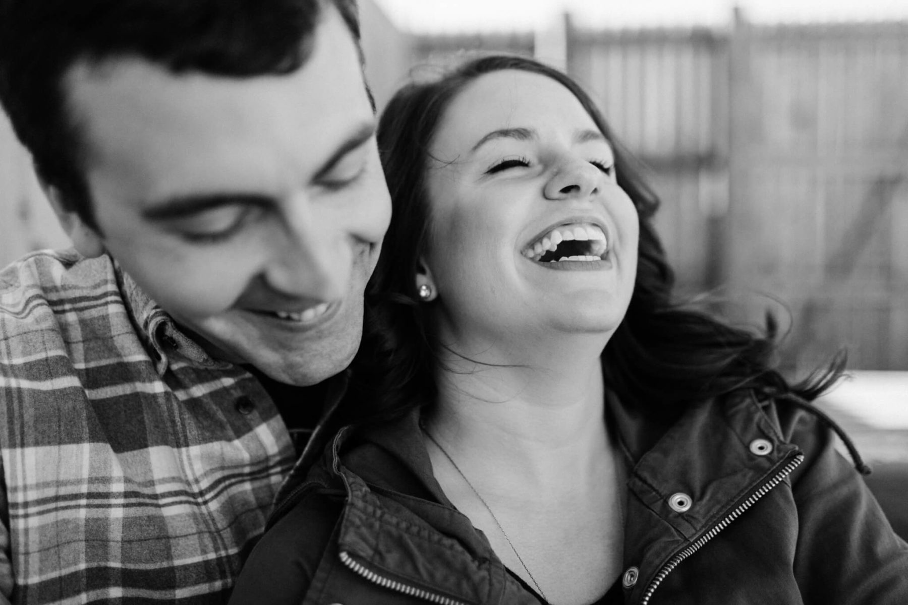 couple laughing together at a brewery