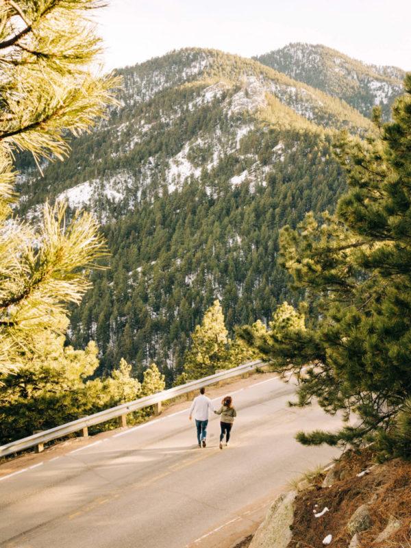 couple runs on a street on a mountain in boulder colorado